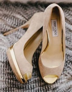 Gold Jimmy Choo wedding shoes. With high heels and slight platform.
