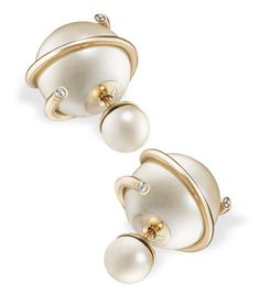 Trend: Stellar Statements. Look: Dior Tribal earrings with gold finish, white resin pearls, and metal ribbon.