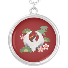 Cute crane with Japanese lucky charms pendant necklaces for women: A white Japanese-style crane surrounded by Japanese symbols of good luck: plum blossoms, pine trees, and bamboo leaves.  Cranes are the symbols of happiness, love, peace, and longevity. Gift idea for birthday, wedding, mother's day, or any other good luck occasions #goodluck