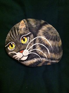 Hand Painted Tiger Cat on a smooth rock. For sale on esty.com search sallystones