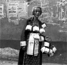 Warsaw, Poland, A woman selling armbands in the ghetto, 19/09/1941.... Heinz Joest was a German soldier posted in the Warsaw area in 1941. It is said that he was given a special leave on the occasion of his birthday and toured Warsaw and the Warsaw Ghetto, when he took these pictures.