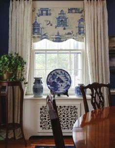 Home decorating ideas - full length white window treatments with beaded trim, blue and white toile roman shade, blue and white pottery display | A Wonderful Palmetto Life