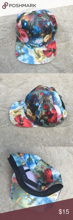 New floral snap back hat New without tags floral snap back hat. Adjustable size. Accessories Hats