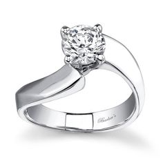 Bold and sophisticated with a flair for the unique this solitaire ring exudes confidence and clarity with a prong set diamond center that nestles into a curving shank. <br />  <br />  Also available in yellow gold, 18k and Platinum.