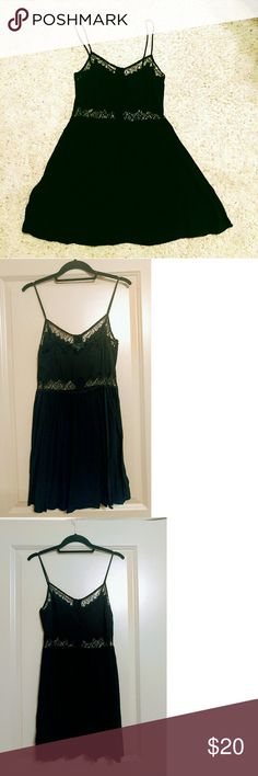 Sundress Dress with Crochet Details Adorable and flirty little black sundress wish crochet detailing. Never worn, but has been washed and hang-dried. Runs small. 100% Viscose. Topshop Dresses Mini