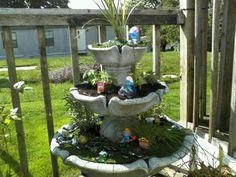 Herb garden in my broken fountain. Fairies instead of smurfs though!
