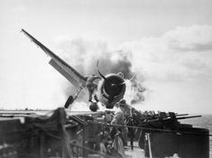 The catapult officer risks his life saving the pilot from a crashed and burning Hellcat on the USS Enterprise, 1943