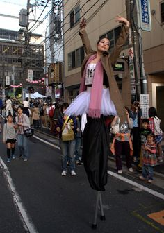 """Entertainment is everywhere, even in between performances venues like this lovely lady on stilts at the Sagenjaya Daidogei (Street performance festival) in Tokyo.  ©Photo by Harry Maison a.k.a BlackManInJapan """"JAPAN'S STREET PHOTOGRAPHER EXTRAORDINAIRE"""""""