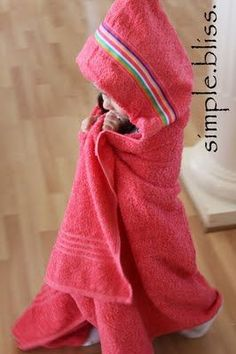 Fabulous sewing project for how to make a DIY hooded towel. These are seriously the BEST baby/toddler/child towels because they are big enough to fit all three phases!