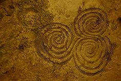 I have a trispiral necklace that I wear nearly every day because the symbol means so much to me. <3    newgrange chamber, 3200 b.c.e. county meath, ireland