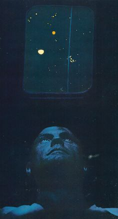 Astronaut John Glenn peers through a simulated capsule window as he observes star groupings at the Morehead Planetarium in North Carolina. Sighting on the vertical blue line which represents his flightpath, he learns to recognise the stars he will need as navigation guides when he gets into space.