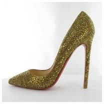 A high heel on women's shoes that is thinner than a spike heel. this a golden stilettos, with 4 inches heel. the front is closed and pointed. Srishti Khera, FD1A2, Task 1.