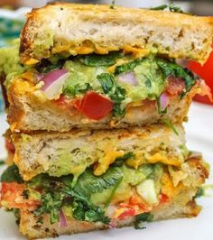 Guacomole grilled cheese sandwich from cookingstoned.com!  INGREDIENTS 2 slices of bread ⅓ cup guacamole  5 fresh sprigs of cilantro 2 slices of tomato ⅓ cup cheddar, shredded ½ tablespoon butter ________________________________________  http://cookingstoned.tv/recipe/guacamole-grilled-cheese-sandwich/