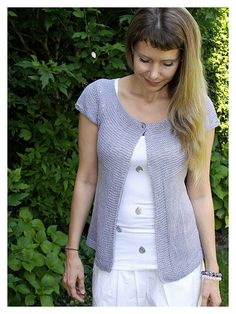 Free knitting pattern for Lavender short sleeved cardigan - schneckenstrick's sweater is knit in the round from top-down with with optional button detail on the sleeves. In English, French, or German.