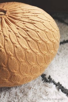 Step-by-step instructions for how to turn a thrift store sweater, into a cute pouf ottoman.