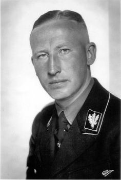 Gründer und Chef des Sicherheitsdienstes Gruppenführer Reinhard Heydrich.  Reinhard Heydrich was the proto-typical Aryan German, as well as an enigmatic, cold, and vicious Nazi.  More than any other single man, even Himmler and Hitler, Heydrich was responsible for the implementation of the Holocaust.  Yet, he was a devoted father who would sometimes weep during moving passages of his favorite music.  He was assassinated in 1942.  His death unleashed Hell on the surrounding countryside.
