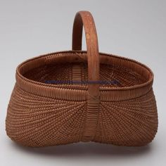 SHELTON SISTERS, FORSYTH CO., NORTH CAROLINA ATTRIBUTED RIB-TYPE EGG BASKET, white oak, extremely finely woven kidney form with delicate wrapped double rim and arched handle