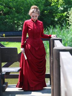 1884 red bustle dress