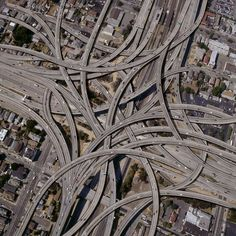 """Complex-Freeway-Interchange-Network"" by john lund, Sausalito, CA // An aerial view of an incredibly complex freeway interchange and cloverleaf. This falls under the category of conceptual landscape and can be used to depict transportation, communication, connection, Internet, world wide web and even neurological issues. This is the... // Imagekind.com -- Buy stunning, museum-quality fine art prints, framed prints, and canvas prints directly from independent working artists and…"