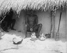 AN ARTIST IN POTTERY. THE FINER AND MORE ELABORATE POTTERY IS DONE BY MEN ONLY. Locale: OKONDO'S VILLAGE, CONGO BELGE
