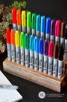 Wooden Sharpie Holder. This wood sharpie holder makes a great desk top organizer. It not only showcases the beautiful rainbow display but to organize the markers and keep them within easy reach!