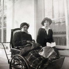Close friend of the Romanov family, Anna Vyrubova in a wheelchair with Grand Duchess Olga in 1915