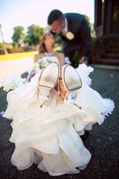 The #couple steals a #kiss. ::Ashley + Danny's purple summer wedding at the Peninsula Park Rose Garden in Portland, Oregon:: #flirty #funloving #heelsup #kickupyourheels #couplesportrait #love #weddingday