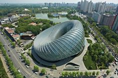 Located between the third and fourth ring roads on the east side of Beijing, the Phoenix International Media Center is a steel torus of structure enclosed with 3,800 glass panels.