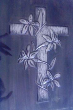 Embossed cross with lilies