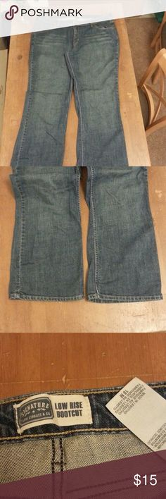 Levi lowrise bootcut jeans Medium wash jean with copper hardware.  Three front pockets and two back pockets. Beautiful condition! Levi's Jeans Boot Cut