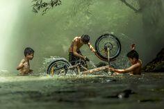 The boys are washing bicycle playfully River Near Home by Jakkree Thampitakkul on 500px