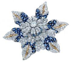 Elizabeth Taylor's sculptural sapphire, diamond, platinum and gold Fleur de Mer brooch by Tiffany & Co.  http://shardsoflondon.com/ #Diamonds #Sapphires #Jewels