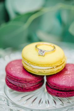 Loving this beautiful solitaire engagement ring, and the macarons make for a perfect photo!