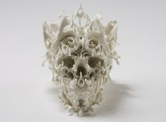 Katsuyo Aoki is a Japanese ceramic artist with a nack for designing intricate skull-inspired sculptures. Winning award after award, Aoki takes the form of a human skull and transforms it into a complicated maze of ceramic beauty Graffiti, Street Art, Human Skull, Skull And Bones, Skull Art, Magazine Art, Ceramic Art, Porcelain Ceramics, White Ceramics