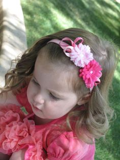 Sweet felt flowers are soft pink and fuchsia and are adorned with a whimsy of ribbons in complimentary shades.