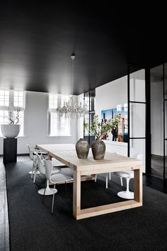 This black gem of a home is located in Belgium in a former rectory. An interior design duo owns the intimate modern home where black is clearly the star Scandinavian Dining Table, Scandinavian Design, Dinner Room, Black Furniture, Home And Deco, Black Decor, Dining Room Design, Interiores Design, Interior Inspiration