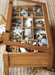I think I need a coffee table like this one, place to display things with out getting dusty and if you get sick of it just change it out
