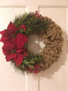 This Christmas wreath for front door is a pretty burlap wreath to add to your Christmas decor. This winter wreath is perfect gift for the holidays. We started with a wreath frame and added rolls of burlap. Then we added two artificial Poinsettia and artificial greenery. This