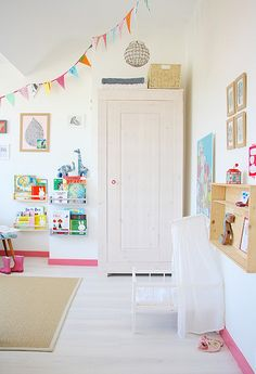 Adorable room! Love the pink baseboards. Decor8