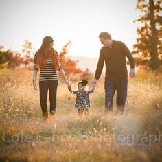 Love the parents looking at their precious daughter!  And the lighting - AMAZING!