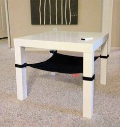 Easily make an under-table or under-chair cat hammock with cloth and Velcro straps.