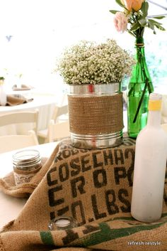 DIY Wedding ideas tin can wrapped in burlap.  Save your glass jars from wine, sauces, spray paint if desired with krylon all directional spray paint, available at Lowes, Home Depot.  If you have difficulty removing the labels, use goo gone, available at Wal-Mart.