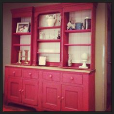 Red hutch in the home of Restoration Emporium's owners #hutch #homedecor #livingroom