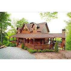 Log house with wrap around porch...