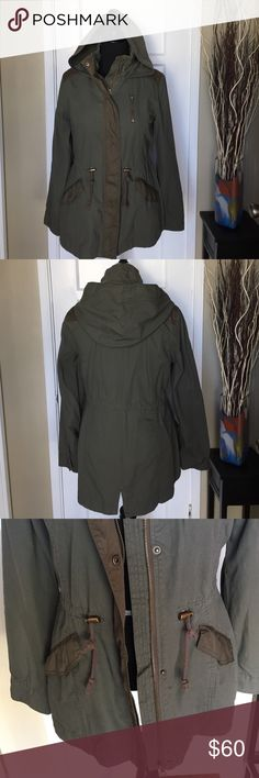 Hooded Anorak Parka by Sebby Collection. This lightweight parka is great for layering. Features attached hood with zip and snap front closure. Long sleeves with button cuffs. Unlined 100% cotton with polyester contrast. Drawstring waistband. 2 snap button pockets. Beautiful olive green color great for fall. BRAND NEW/NEVER WORN WITHOUT TAGS. Offers welcome! Sebby Jackets & Coats Utility Jackets