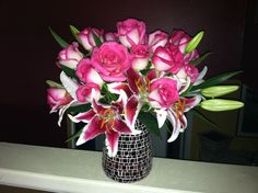Rose and lilly Mother's Day arrangement by the paisley petal.