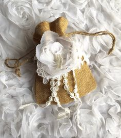 A personal favorite from my Etsy shop https://www.etsy.com/listing/234432685/wedding-money-bag-rustic-burlap-bag