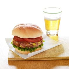 Corn and Bean Burgers | In food processor, pulse beans, ½ c. bread crumbs, and ¼ tsp. each salt and pepper until ground. Add 1 c. corn kernels and ½ c. shredded sharp Cheddar cheese; pulse to just combine. Form into 4 (4-in. round) patties. Coat 12-in. nonstick skillet with cooking spray. Add patties; coat with spray. Cook on medium 15 minutes or until browned, turning once. Serve on buns with lettuce and tomatoes. Serves 4.
