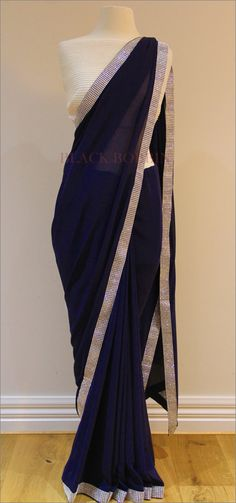 Black Bobbin - Featuring a rich navy blue Georgette saree with a silver sparkling border. It comes with an un-stitched white sequin blouse piece as per the photo. This stunning saree is perfect for a special occasion, day or night event. Contact us: blackbobbinmelbourne@gmail.com