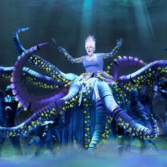 Ursula getting ready to throw Flotsam and Jetsam off stage in The Little Mermaid.